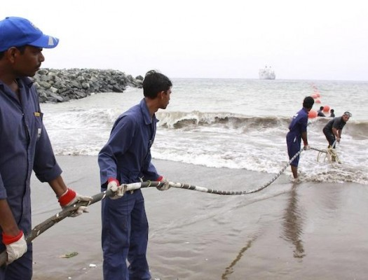 Image #: 7610770    Alcatel-Lucent contractors lay the East African Marine Cable (TEAMS) fibre optic cable on the Fujairah shore-end, April 10, 2009. Foreign navies have agreed to protect a vessel installing an undersea high-speed Internet cable from pirates off the coast of Somalia, a Kenyan minister said on April 16, 2009. Sea gangs from lawless Somalia have been increasingly striking the Indian Ocean shipping lanes and strategic Gulf of Aden, capturing dozens of vessels and hundreds of hostages in attacks that have driven up insurance rates.  REUTERS/Gina Din Corporate Communications/Japheth Kagondu /Landov